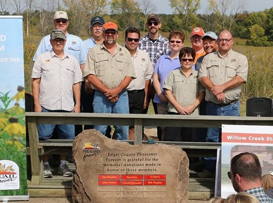 Pheasants Forever volunteers celebrate the dedication of the Willow Creek State Habitat Area in Edgar County, Ill.